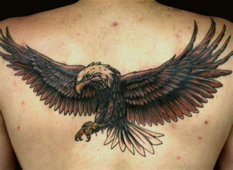 tattoo eagle flying open wings flying eagle tattoo on upper back
