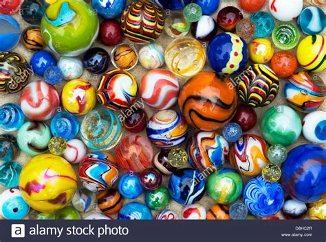 colorful marbles colourful marbles on sand pattern stock photo royalty