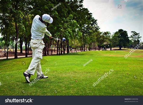 swinging golf club golfer swinging his golf club and hit the golf ball from