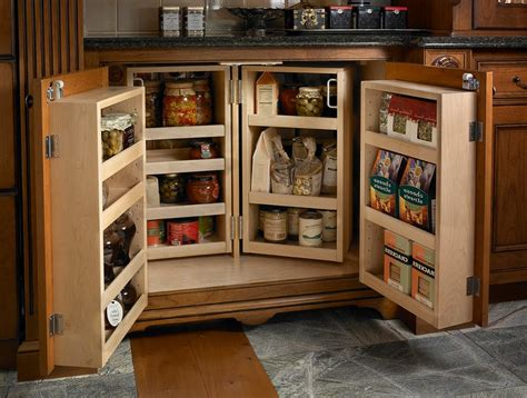 dog food storage cabinet kitchen traditional with light wood shelves round containers base