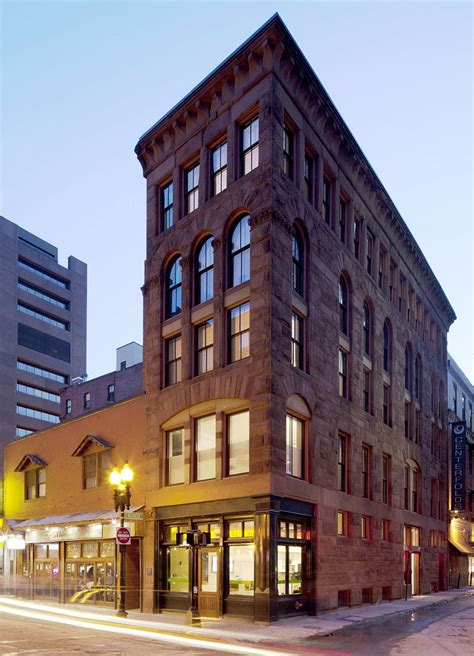 building exterior office building in boston transformed into a grand multi family residence