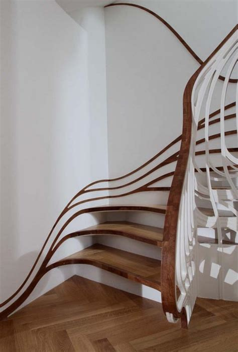 Banister Designs by Banister Bending Staircases Take Handrails To New Heights