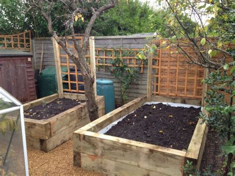 Building A Raised Bed With Sleepers by Railway Sleepers