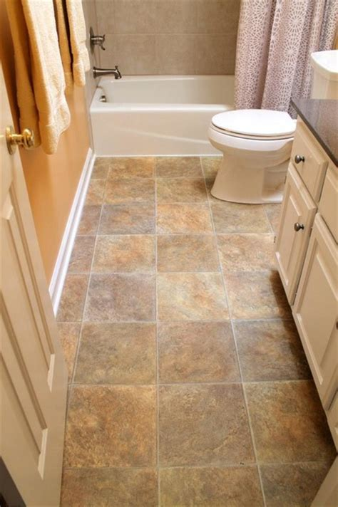 vinyl flooring bathroom ideas vinyl floor kohler toilet in white tile tub surround