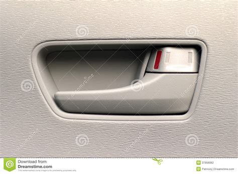 interior door handles for cars up of an interior car door handle stock photography