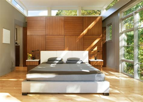 wood paneling bed and clerestory windows in the bedroom