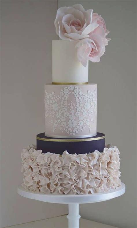 unique  tier pink white gold  navy wedding cake