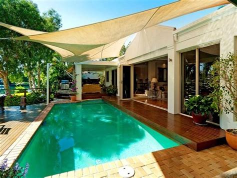 in ground pool design using pavers with bbq area amp shade