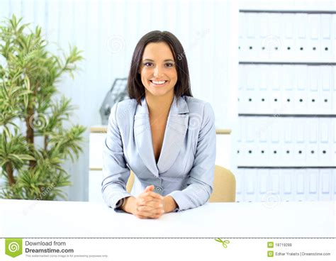 portrait of pretty sitting at desk royalty free stock