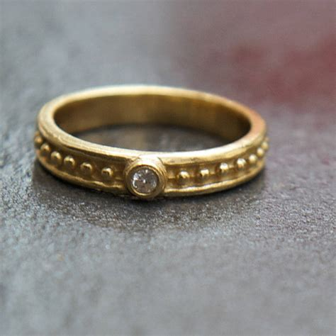 hammered gold band ring with solitaire white zircon by