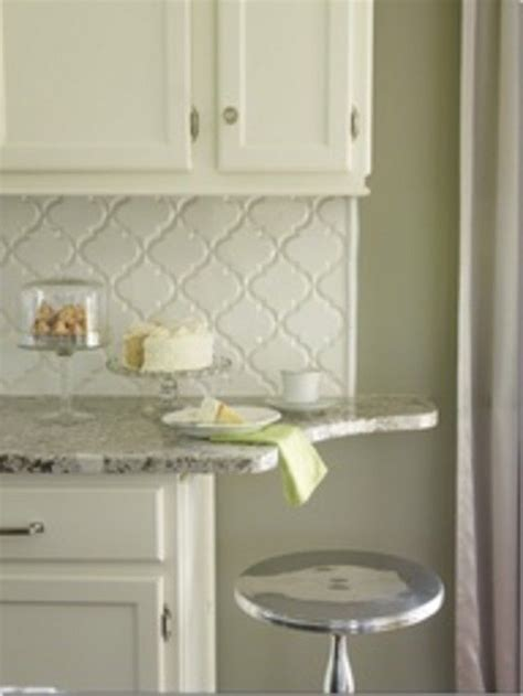 do you tile under kitchen cabinets where do i end the backsplash cabinets shorter than