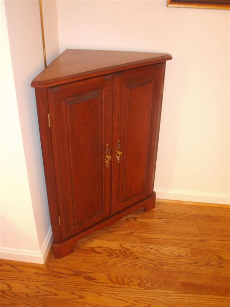 lovely brown wooden small corner cabinet furniture designs
