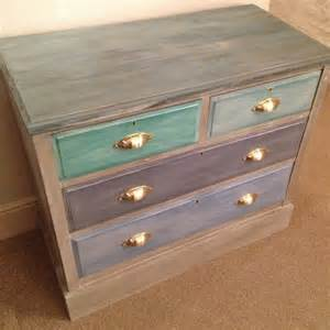 multi coloured painted chest of drawers blue