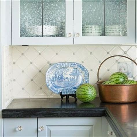 light blue accents give this white kitchen backsplash a