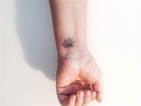 small flower tattoos on wrist 79 attractive lotus flower wrist tattoos design
