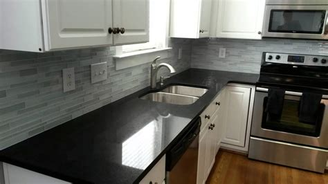 Kitchens With Black Countertops White Kitchen Cabinets With Black Quartz Countertops Quicua