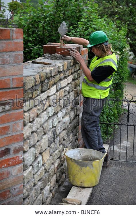 Building Of A Garden Wall With Cotswold Stone And Reclaimed Brick Garden Walls