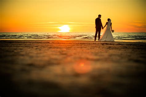 sunset wedding   Janis Konons Photography