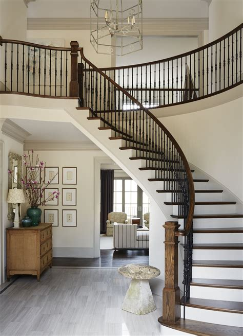 grand curved stairway design  entryway amy meier