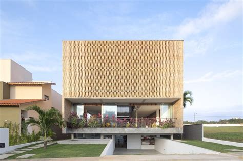 Residential Building Plans a residence with a perforated brick facade and a dual nature