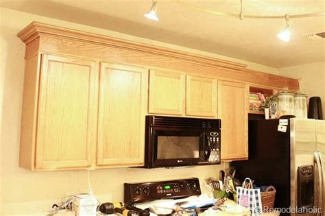 How To Update Kitchen Cabinets With Molding Update Builder Grade Cabinets Fast Without Painting Chairs Chair Rail Molding And Crowns