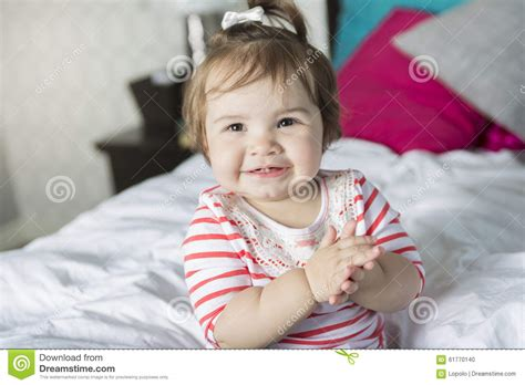 one year old bed one year old girl in bed stock photo image 61770140