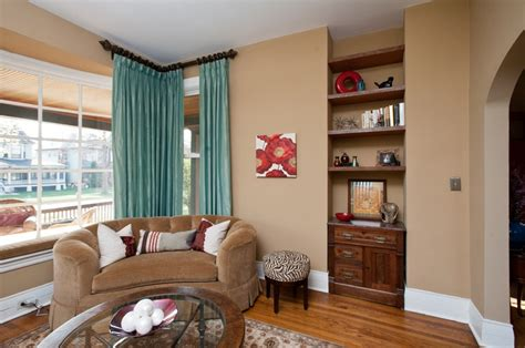 light teal living room living or seating room light teal draperies neutral beige walls white trim and purple