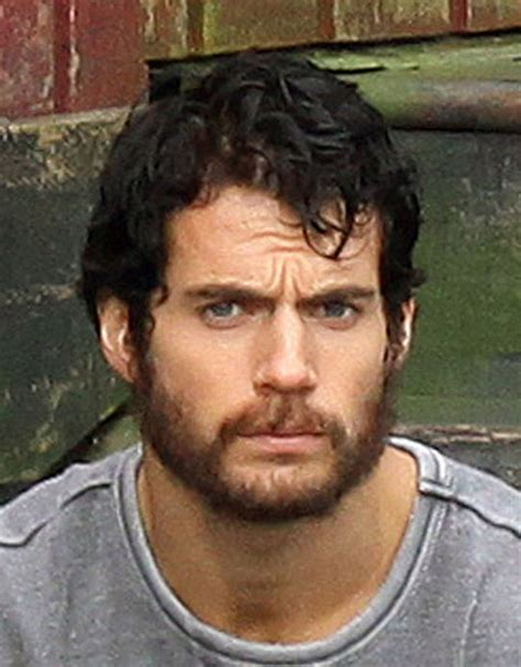 henry cavill superman beard man of steel set photos show a bearded henry cavill