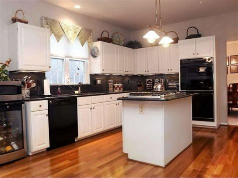 black kitchen cabinets with white appliances our pick on the best kitchen design trends