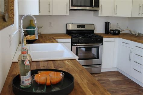 wood floors in kitchen with wood cabinets modern white cabinets and acacia wood floor modern