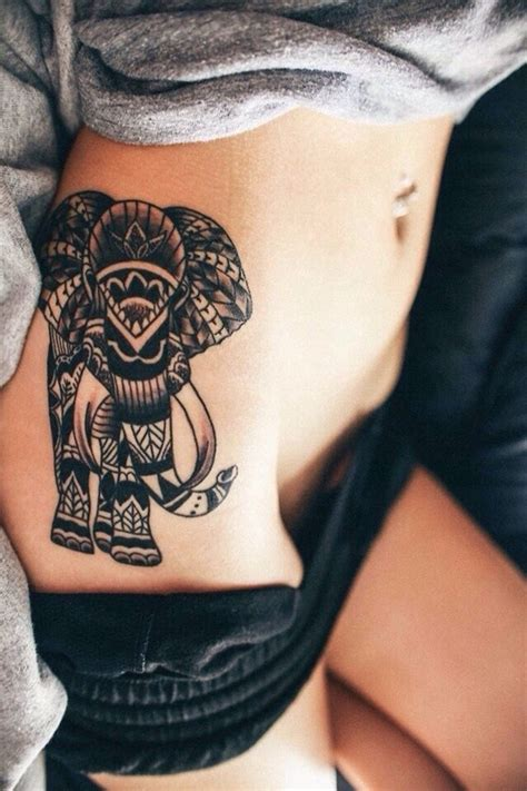 elephant tattoo on stomach 60 best elephant tattoos meanings ideas and designs 2018