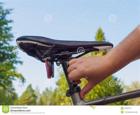 adjusting bike seat adjusting a bicycle seat stock photo image 43423116