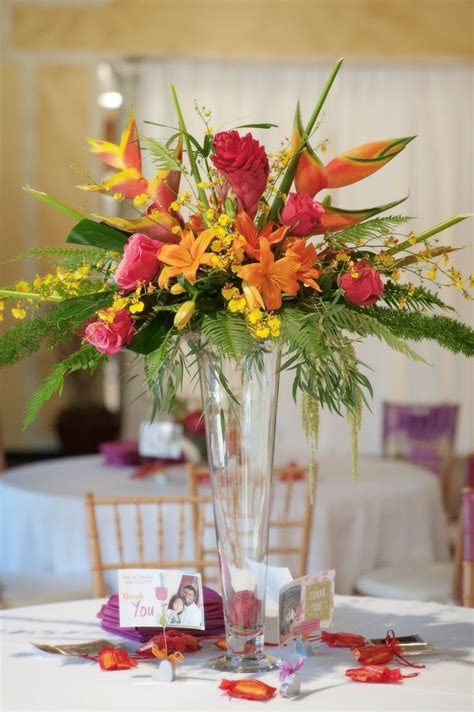 best 25 tropical centerpieces ideas on luau wedding hawaiian centerpieces and luau