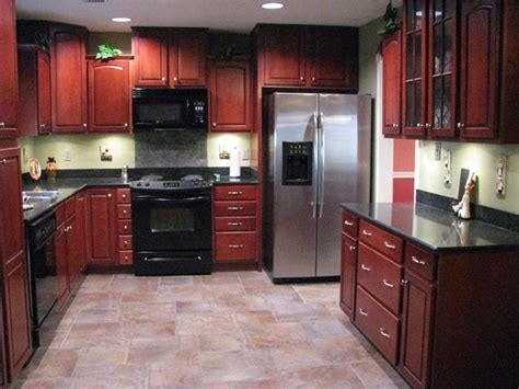 cherry cabinets with wood floors porcelain tile plank floors with cherry cabinets been