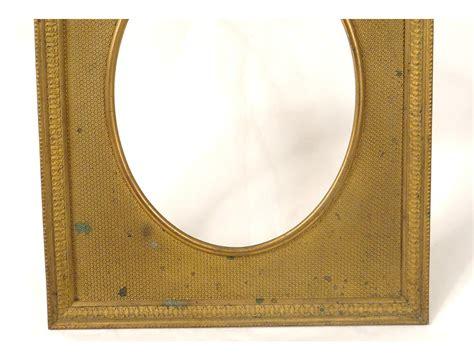cadre renaissance bronze dore putti angelots guirlandes