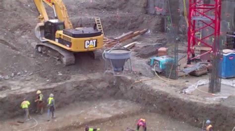 pouring concrete cement truck crane construction excavation site