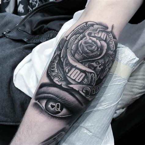 tattoo rose and eye black and grey money rose with skull and eye tattoo on forearm