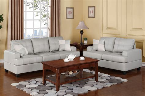 Grey Leather Sofa And Loveseat Gray Leather Sofa And Loveseat With Tufted Saddle And Back Placed On Cherry Hardwood Floor Of