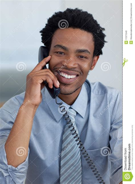 afro american afro american businessman on phone stock photo image