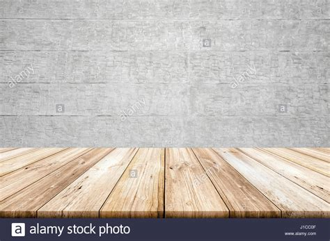 light wood table top empty light wood table top with concrete wall background
