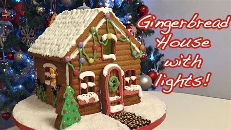 decorated gingerbread house with lights cheeky crumbs