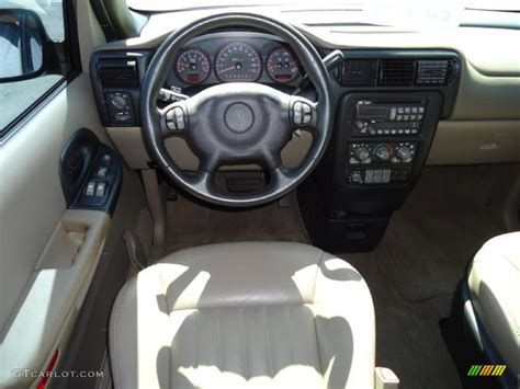 Home Interior Shows 2004 Pontiac Montana Standard Montana Model Taupe