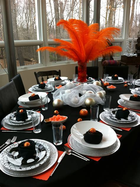 Feathers, orange, black and white birthday party table
