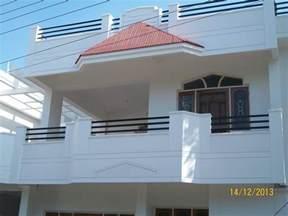 Duplex house balcony with sloped roof amp wooden door window frames