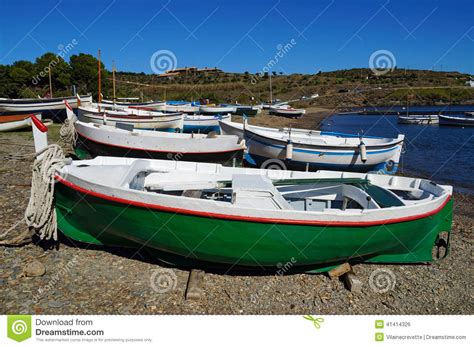 boat time in spanish traditional spanish fishing boats on the beach stock photo