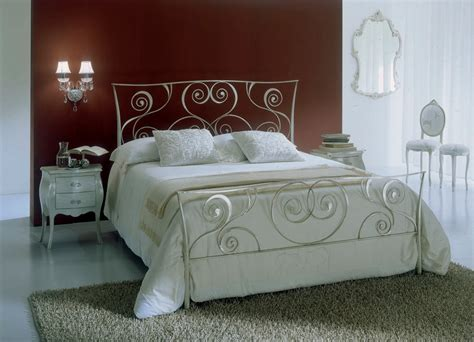white wrought iron bed white bontempi macrame wrought iron bed against brown wall