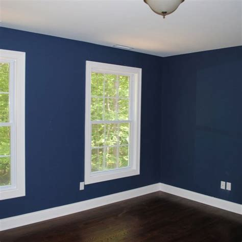 blue painted bedrooms benjamin moore newburyport blue paint color man room mom s living room pinterest