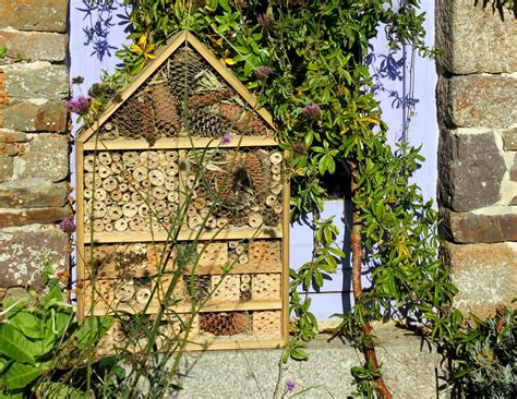 home made repurposed wood luxury insect hotel or five