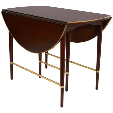 expandable dining table by paul mccobb for the connoisseur