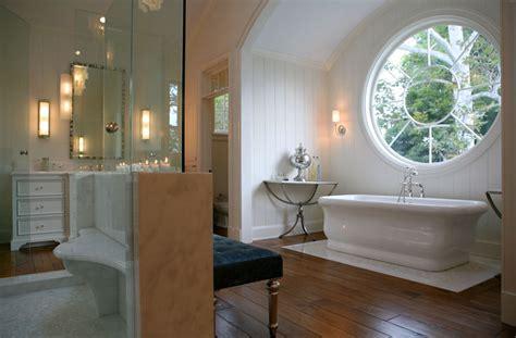 round bathroom window arched bathtub alcove transitional bathroom